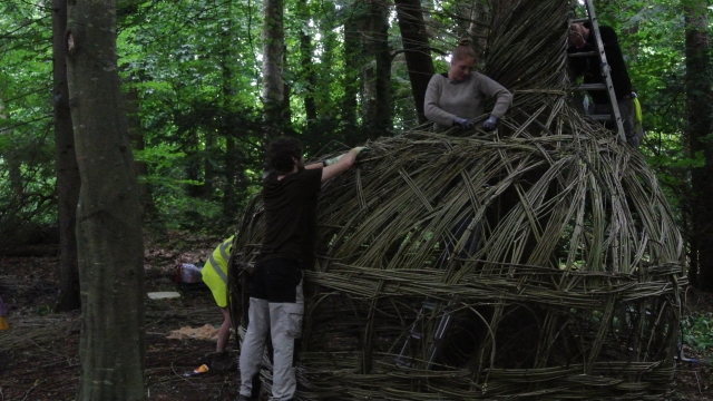 Putting the finishing touches to the wicker.