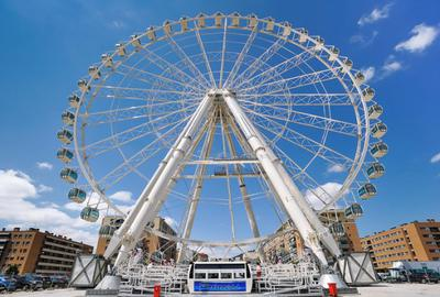 xmalaga-ferris-wheel-noria-mirador-princess-21829465.jpg.pagespeed.ic.PYLq_Mocmi